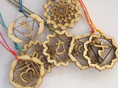 All 7 Chakras Wood Pendants. Poplar wood in burnt tone. 5 cm in diameter (1.97 in). Waxed cotton cord in 7 colors