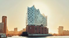 After years of waiting, Herzog & de Meuron's Elbphilharmonie concert hall in Hamburg, Germany, finally has been given an opening date. Parasite Architecture, Rotterdam, Destinations, Old Bricks, Hall Design, Concert Hall, Zaha Hadid, Willis Tower, Architecture Details