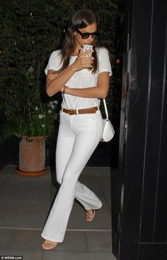 Looking all white! Irina Shayk paraded her stunning model figure in an all-white ensemble ...