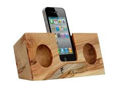 Solid wood dock. It amplifies the iPhone's built-in speaker using hand-cut acoustic chambers, boosting your device's volume up to four times—all without using electricity. by KOOSTIK