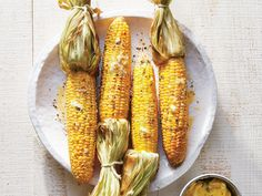 Applewood Smoked Corn on the Cob | Cooking Light | We love the warm, slightly sweet smoky flavor applewood gives the corn. Hickory chips might overpower here, but cherry chips would also w...