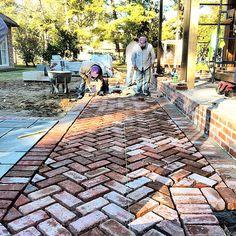 Brick paving in herringbone pattern More
