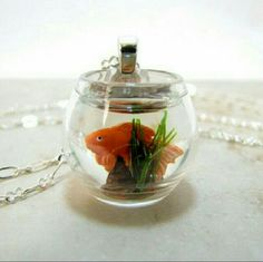 Goldfish Bowl Necklace World's cutest necklace! The adorable little fish is so quirky and happy in his little bow complete with his very own rock and plant! Jewelry Necklaces