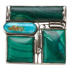 "brooch by Josef Hoffman for the Wiener Werkstatte (1915) , 900 silver, malachite and turquoise, 1 3/8"" h x 1 1/2"" w"