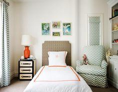 Orange/white bedding with aqua/white chevron stripe curtains...love