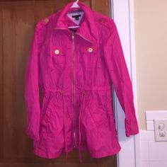 Hot Pink Raincoat/ Windbreaker from Tommy Hilfiger This brand new Tommy Hilfiger can either be worn as as coat, raincoat, or windbreaker. The choice is yours. A great addition to your closet because of the amazing color it is. In addition, there are different ways to make this item fit tighter, by pulling on the drawstrings. Tommy Hilfiger Jackets & Coats Trench Coats