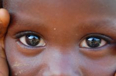 Eyes are the window into the World, are these of joy or of hunger how can we know for sure, pray and find peace. Joyce Poppen