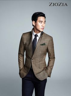 Go for a classic style in a brown blazer and navy suit pants.