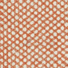 Wicker Linen Fabric A bold linen fabric with a wickerwork design printed in terracotta on a natural ground.