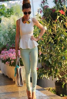 Mint green jeans, a white peplum top, and a bold statement necklace.