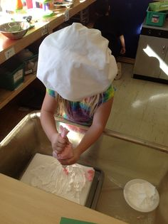 """Cake decorating at Bakery. Colored shaving cream for frosting and real decoraters tips and bags. Styrofoam """"cake"""""""