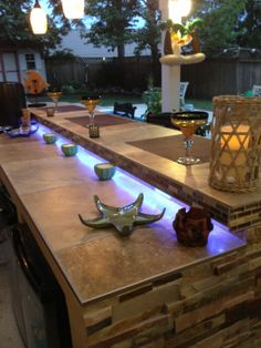 totally digging the lights under the counter.  Add a fun party vibe and enough light to make a drink.