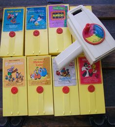 Vintage 1970s Fisher Price 460 Movie Viewer & 8 Movie Cartridges - ALL WORKING - Walt Disney, Warner Bros, Sesame Street - Fun Toy. $94.00, via Etsy.