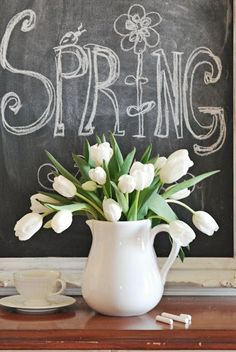 Spring chalkboard and a white tulip bouquet. LOVE the white tulips!