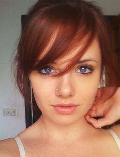 auburn red hair and long wispy fringe