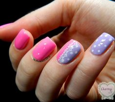 An adorable looking polka dot inspired pink nail art design. The design also incorporates the color periwinkle with lighter shaded dots to compliment the pink shade.