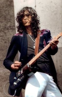 Jimmy Page. Original duckface. (Check out the pants)
