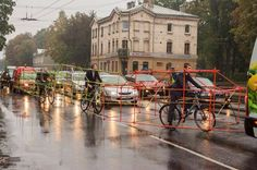 cyclists denounce space occupied by cars. Riga.