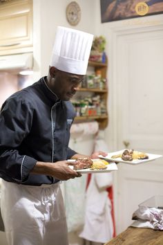 Chef Thierry Manda serving the main courses.