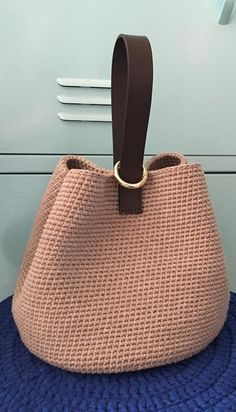 We don't have to tell you this, but the type of handbag you carry says a lot about your sense of sty Crochet Bowl, Bag Crochet, Crochet Bracelet, Crochet Handbags, Crochet Purses, Baby Boy Crochet Blanket, Diy Bags Purses, Vintage Crochet, Handmade Bags