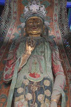 An imposing painted and gilded Buddha at the Dafo Temple in Zhending,  Hebei province, China.