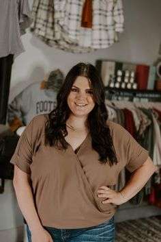 We know you're going to love this top! How could you not!? It's super flirty and fun! Great for dressing up or wear it casually with jeans. It features a layered-look draped front, cuffed sleeves, and is made of good quality linen fabric. #shopnoragray #noragrayboutique #midwestboutique #fashionover30 #indianaboutique #boutiquefinds #boutiqueclothing #boutiqueshopping #curvyfashion #curvystyle #plussizefashion #plussizestyle #curvygirlstyle #curvygals #styleinspiration Curvy Girl Fashion, Plus Size Fashion, Dobby Weave, Boutique Clothing, Boutique Tops, Layered Look, Cuff Sleeves, Linen Fabric, Overalls