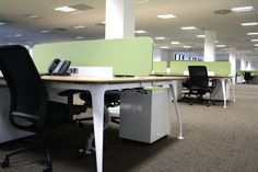 The modern office furniture continued the earthy colour scheme with an oak finish and screens on the desks in the featured colour, which included built-in power sockets.