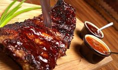 Groupon - $ 44 Ribs and Buffalo Wings with Onion Rings, Salad + Chips for Two People at Award-Winning Stones Restaurant ($90 Value) in Springfield. Groupon deal price: $44