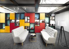British studio Snook Architects used industrial materials, reclaimed furniture and colourful storage units to transform a 550-square-metre loft in Liverpool into an office for creative agency Uniform