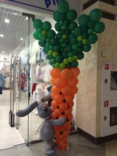 Cute Easter Bunny balloon decor. That's quite a carrot he's got there. :-)