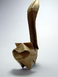 Criação de Gato em origami  Gato criado por mim a partir de um retângulo medida 2x1.