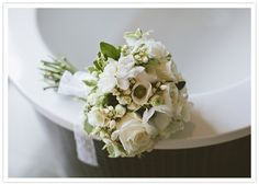 all white bouquet and lace ribbon