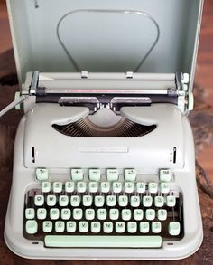 mint green or pale blue typewriters <3