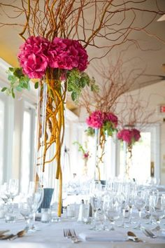 Floating, magical tower centerpiece... fuschia hydrangea and curly willow with seeded eucalyptus.