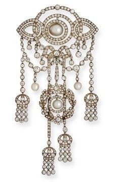An Antique Pearl and Diamond Pendant Brooch, probably by Cartier, circa 1900. Of openwork design with foliate garlands and swinging tassels, decorated throughout with old mine and old European-cut diamonds and pearls, pearls set in platinum, together with pendant and brooch fittings, mounted in gold-backed silver, unsigned, with box stamped Cartier, 13 rue de la Paix Paris, 4 New Burlington St London.