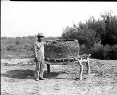 Captain Luis Torres of the Coahuilla Indians standing beside a mesquite granary at Torres, east of Palm Springs, :: California Historical Society Collection, Primitive Survival, Indian Village, University Of Southern California, Cultural Diversity, Old West, Historical Society, Native American Indians, Outdoor Furniture, Outdoor Decor
