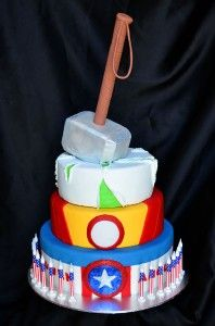Avengers cake. I wonder what the hammer handle is made of.