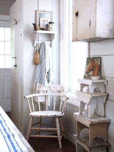 Country kitchen, stepping stools and worn paint