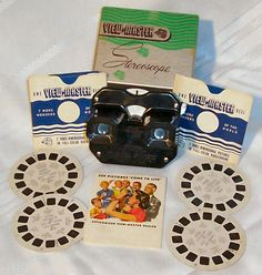 View Master...I love the story my husband told me... when he was a little boy and was home sick with the flu he would pass the time looking at different photo's with his View master. He still has his View Master with all the reels and it looks a lot like this one.