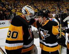 APRIL 23: Matt Murray #30 celebrates with Conor Sheary #43 of the Pittsburgh Penguins after a 6-3 win over the New York Rangers to clinch the series in Game Five of the Eastern Conference First Round during the 2016 NHL Stanley Cup Playoffs at Consol Energy Center on April 23, 2016 in Pittsburgh, Pennsylvani
