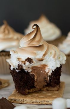 These are the perfect s'mores cupcakes: a graham cracker base, soft and decadent chocolate cake, gooey Hershey's chocolate buttercream center, and toasted marshmallow frosting. Recipe includes nutritional information. From http://BakingMischief.com