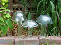 "Kinda cute glass ""mushrooms"" for the garden."