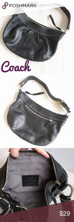 """Coach Hobo Shoulder Bag Genuine Leather The outside of this Coach bag is in perfect shape, the inside, not so much. Inside has some staining near the zipper and the pockets. Soft black leather. All hardware is in great shape. Coach is embossed on the front. Wide strap with a large silver buckle.  Measurements: 13"""" wide,  9"""" deep,  8"""" strap drop. Coach Bags Hobos"""
