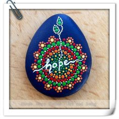Vibrant inspirational dot painted stones that contain and emphasize the words:  hope, adopt, love, friends, forever