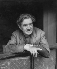 Austin Osman Spare (English artist/occultist 1886~1956) at the window of his flat in Brixton, South London, 1953.