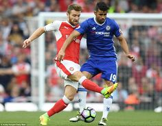 Arsenal's German defenderShkodran Mustafi kept a close eye on powerful Chelsea striker Diego Costa early on
