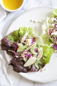 Updated Waldorf Salad Cups –a lighter take on the classic Waldorf Salad served in lettuce leaves so you can eat them with your hands instead of a fork!
