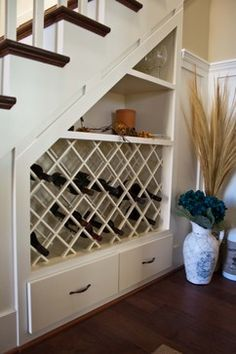 Great use of under stairs space, we may have to consider a wine rack in our utility room!