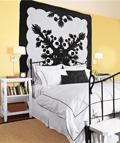 "DIY Artwork  Hanging a graphic quilt is an easy solution to the ""big blank wall"" issue. Complementary bed linens pull the decor together."