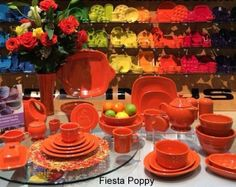 Table Display of Fiesta Poppy, Fiesta's New Color for 2014! This picture shows how this color fits between tangerine and scarlet (on back wall) More details and purchasing info at http://dinnerwareusa.com #fiestacolors #fiestapoppy #fiestaware